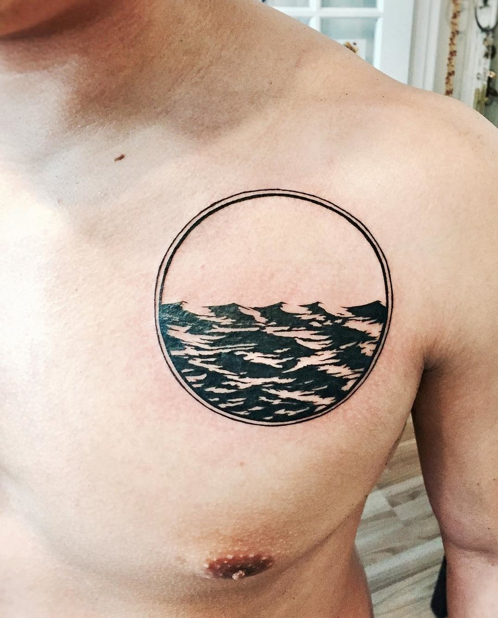 Ocean_waves_tattoo_I_did_while_back_on_Chase____.jpg