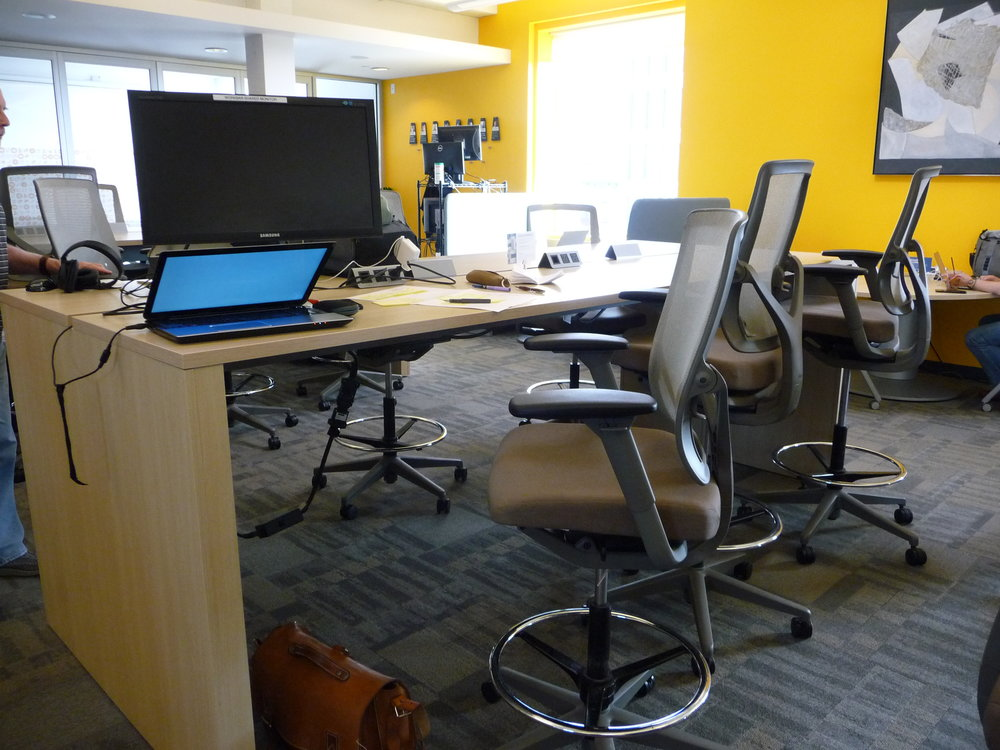 Workbar provides ample standing desks and external monitors for members to use.