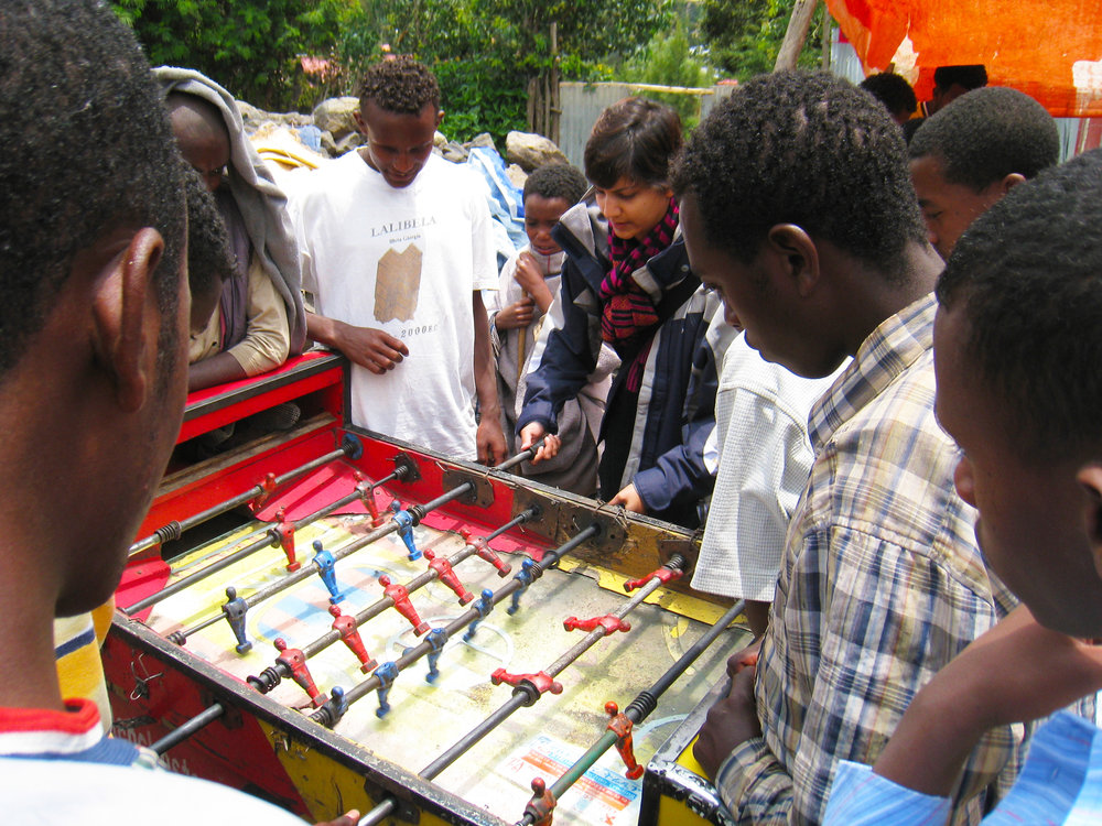 Playing foosball with villagers in Ethiopia.