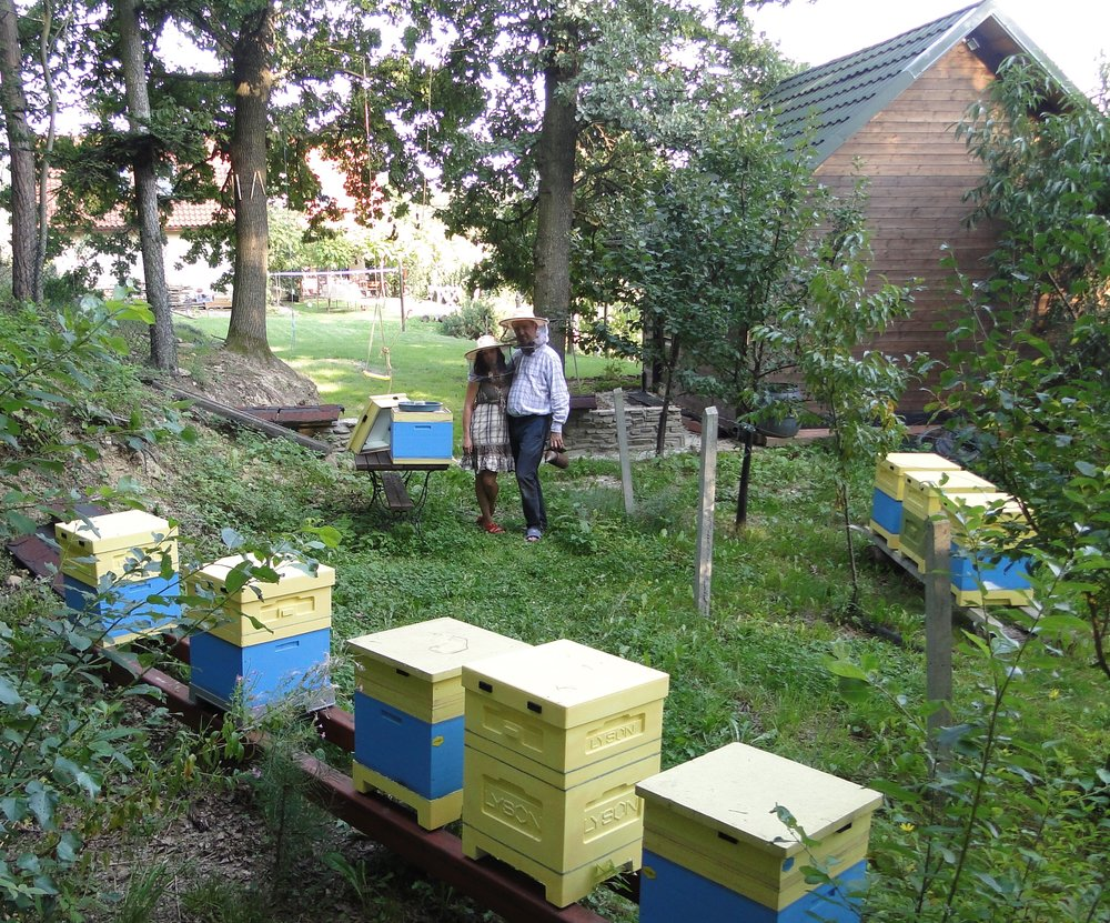Michal with his wife at their apiary
