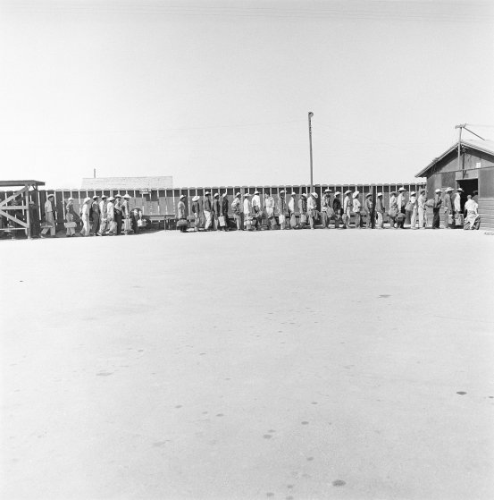 Circa 1957: Mexican laborers in line at a reception depot for processing and assignment in California.  (Photo:  Time.com )