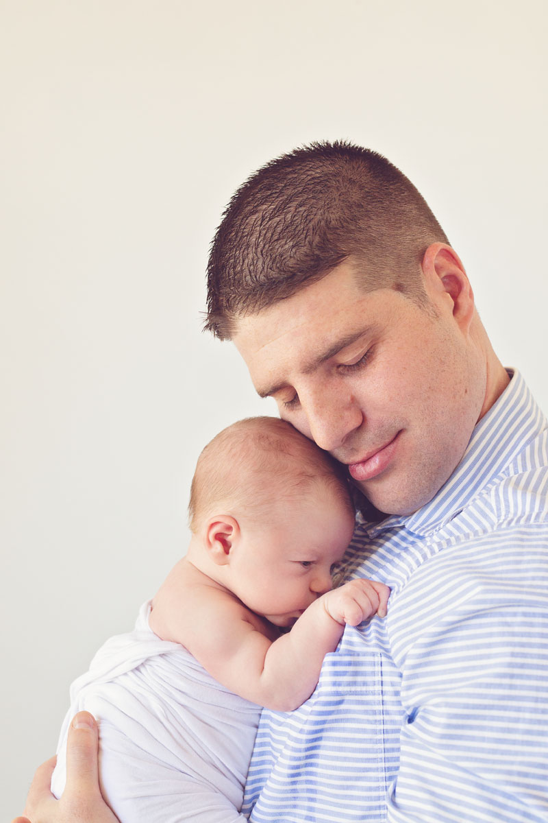 professional photograph of a dad with his newborn baby