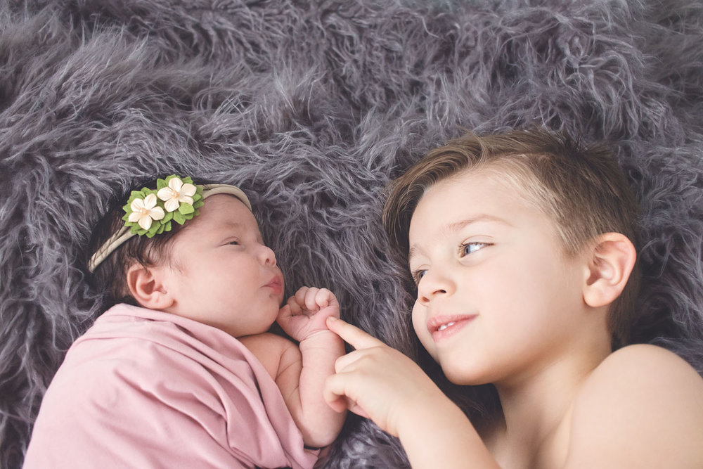 newborn baby girl with her older brother