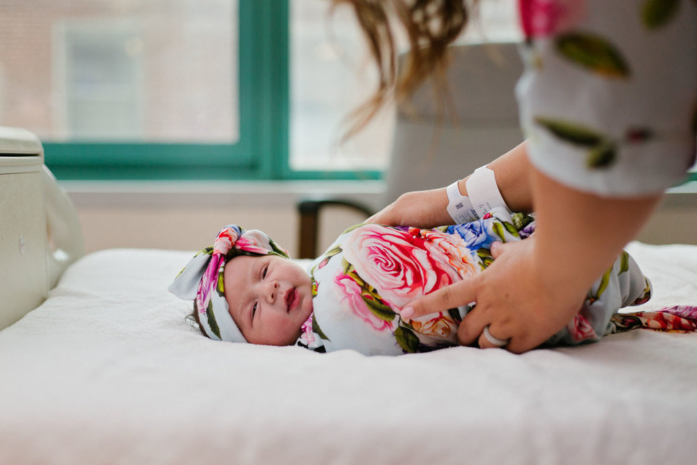 Fresh 48 Photography of newborn baby girl on hospital bed in Mountainside Hospital in Montclair New Jersey