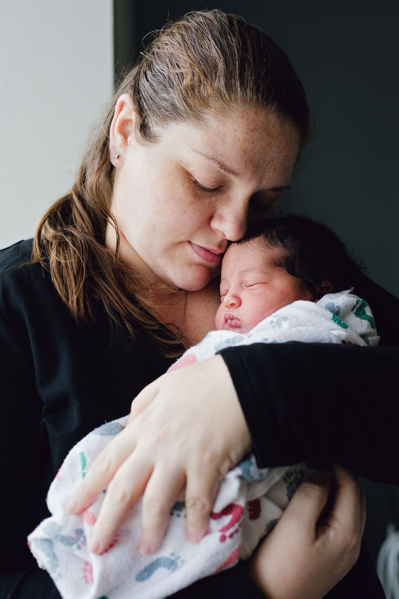 Fresh 48 Photography of newborn baby girl in moms arms in Hackensack Hospital in Hackensack New Jersey