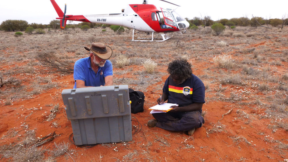 Roger Williams from Oak Valley with magnetotelluric installation on Maralinga Tjarutja Lands, South Australia with Dr Bruce Goleby from The University of Adelaide. Image: Tim Anderson, Helifarm.