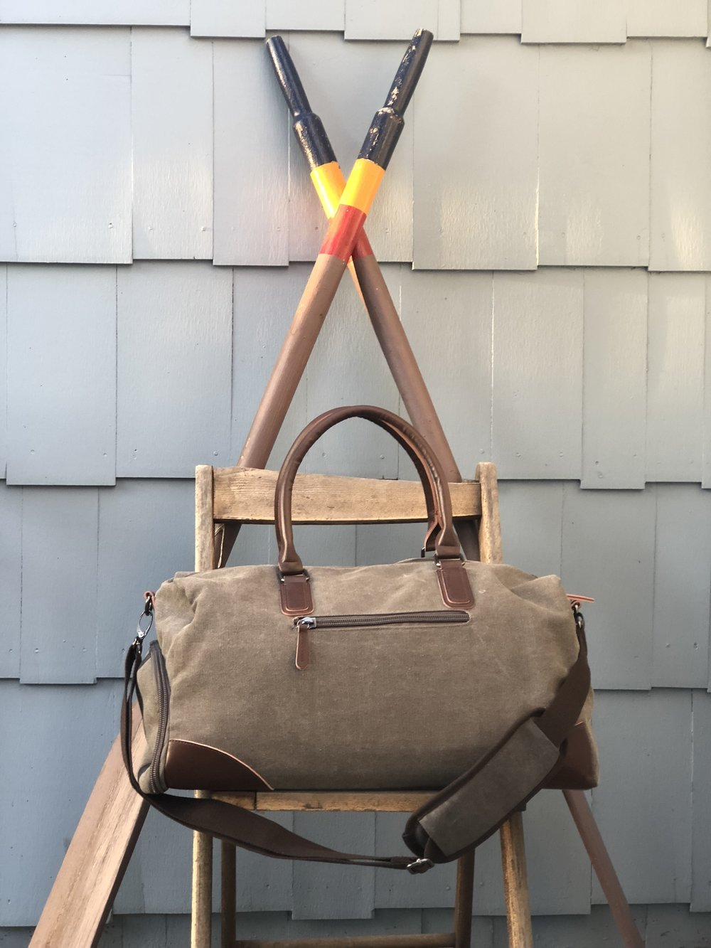 - This Weekender Bag is perfect for each of us to bring on any four day trips. It has a large zippered shoe pouch at the bottom of the bag, and inside the bag there are organized compartments. It also comes with a large toiletry case. At less than $50 it's the perfect nicer gift for anyone you know who travels.