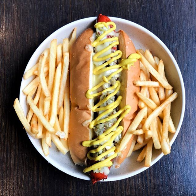 Wagyu Krawsky served with Sauerkraut, Mozzarella, Gherkin Relish, American Mustard and a side of Hand Cut Fries 🍴 . . . . #thelane #sydneycafe #lunch #special #wagyu #hotdog #restaurant