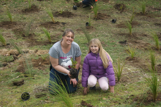 A family from our community helping us plant—ka pai!