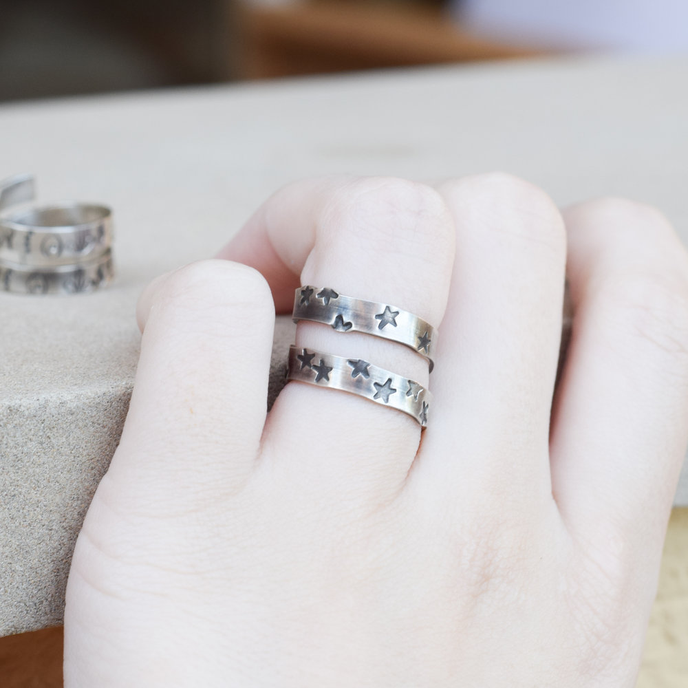 Open ended wrap around ring with a hand stamped pattern