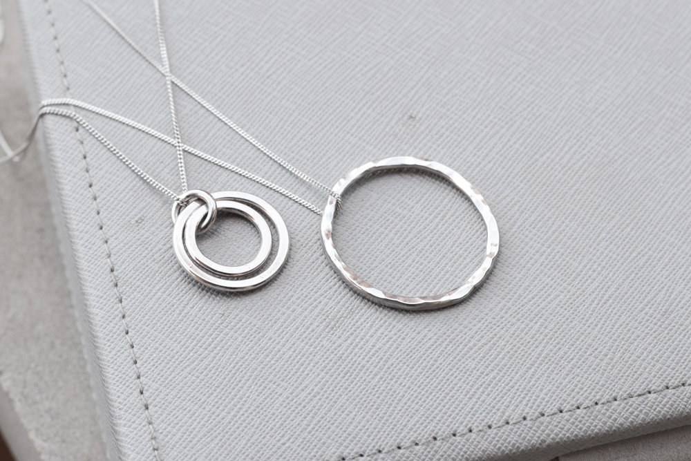 Hand made from scratch karma loop necklaces in sterling silver