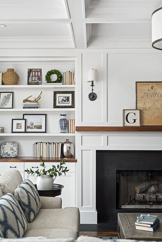 Framing a fireplace with shelving, allows for personal items to be on display. Creating an entire wall as the focal point.