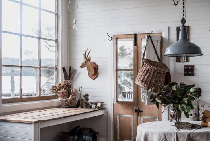 "Glass doors in the kitchen have been replaced with antique french doors that are more beseeming to the original cottage feel.  The kitchen was designed not for practicality but one of beauty. ""A place to play with collections, make a mess and able to hide all the dishes in the sink."""