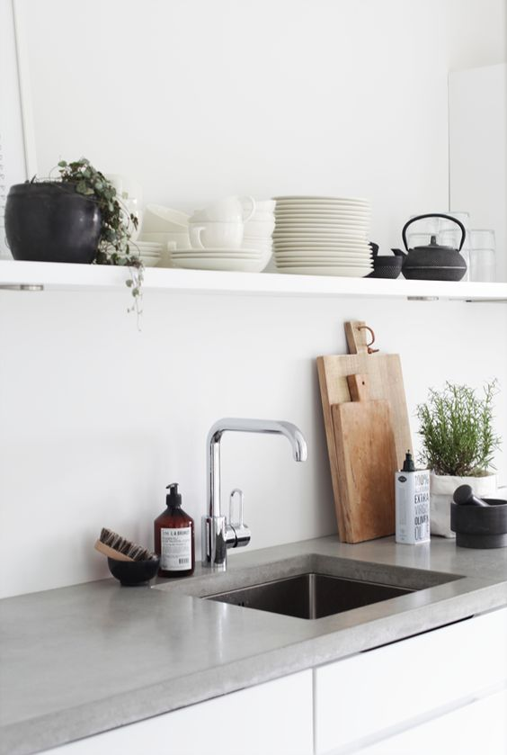 3. Sink styling  Most of us will have dish soap or hand soap next to the kitchen sink — why not turn this area of the kitchen into a stylish arrangement with a few easy steps.  Start with a tray, look for soap products in beautiful packaging or place them in ceramic soap pumps. Add interest with an indoor plant and/or candle, and you can also add texture with an item such as a natural bristle brush, like a pot scrubber.