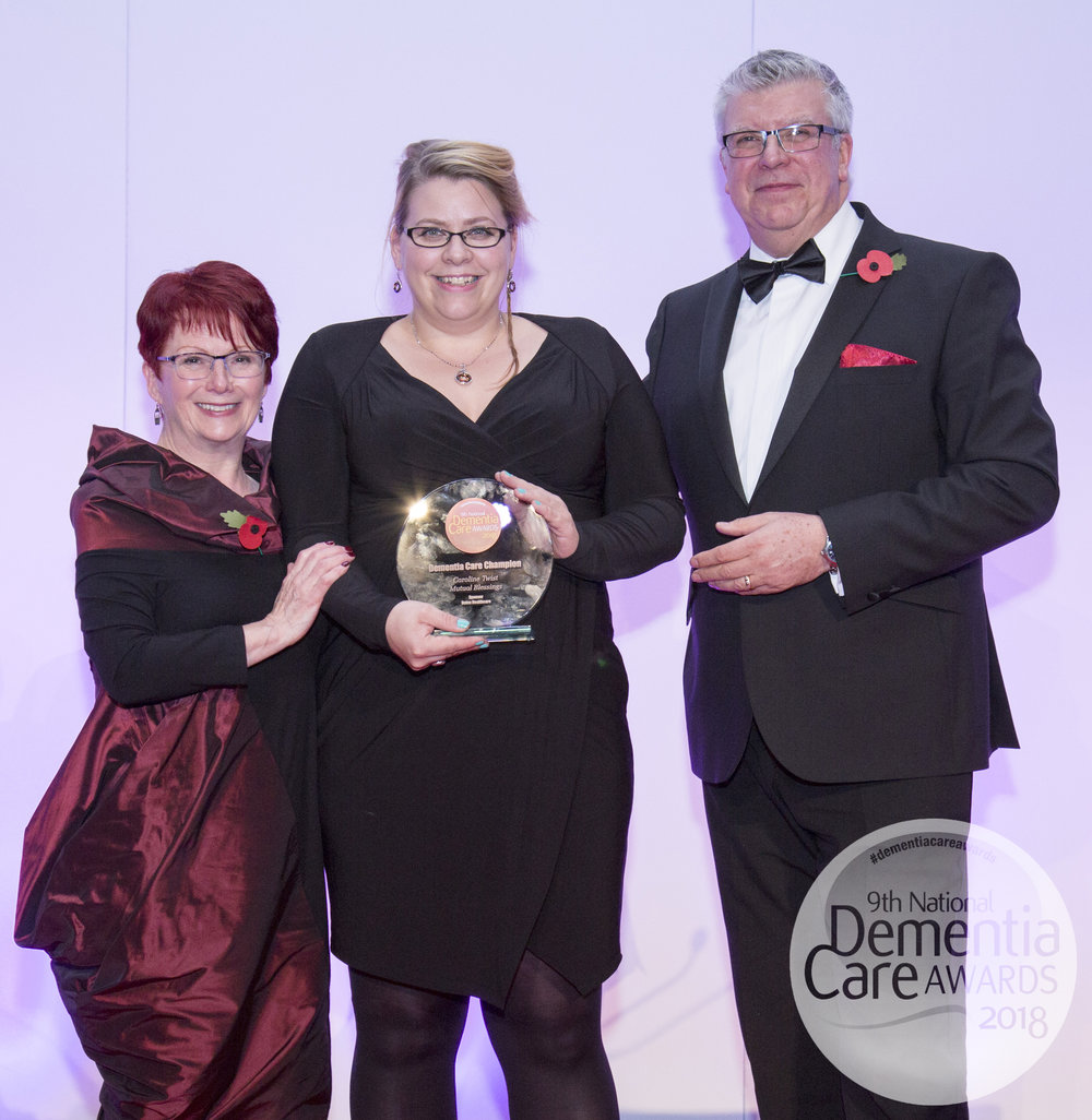 Caroline Twist receiving the Award