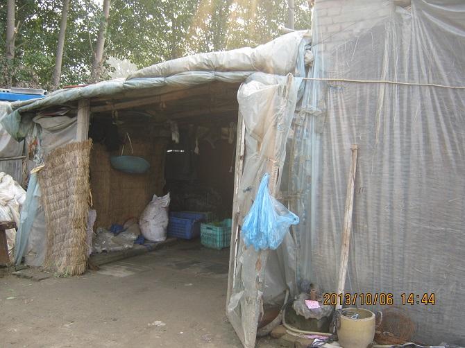 Kuva: Siirtolaisperheen asumus Pekingissä (kuva: Koulun arkistot)