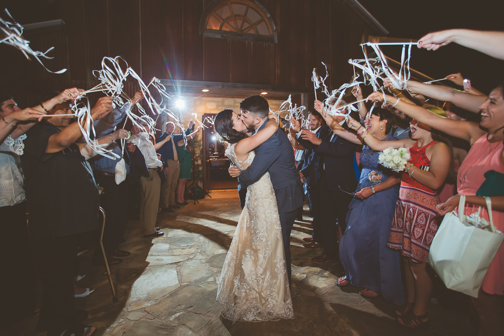 heritage-haus-austin-wedding-venue-rustic-elegant-traditional-grand-exit-bride-groom-wedding-hill-country-barn
