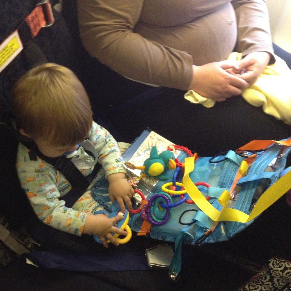 Bambino using the Toddler Travel Center mid-flight