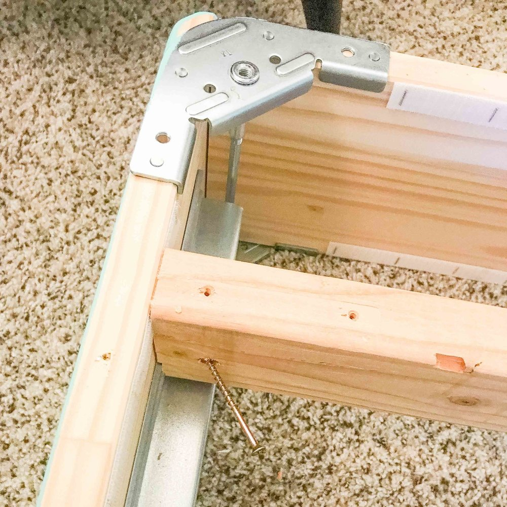 1. Attach the 2x4 to Espevar's side pieces with a screw.
