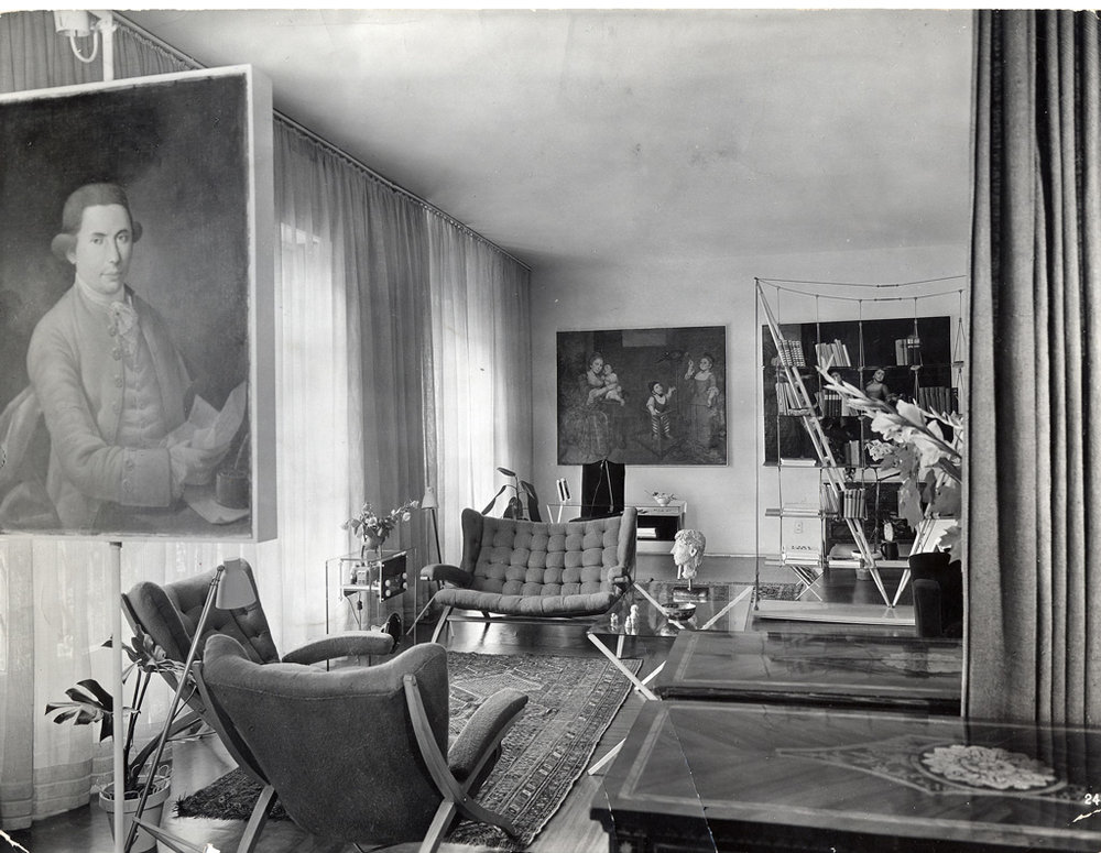 Franco Albini's home in Milan, with the original Veliero Bookcase built in 1940. The Bookcase was destroyed 15 years later, when vibrations from his son's loud music caused the glass to shatter and break. Cassina worked with aeronautical engineers to reinforce the design's structure, releasing it to the public in 2012.