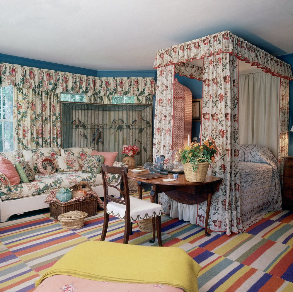 Sister Parish could always teach old dogs new tricks - especially chintz. She loved re-mixing the timeless British Colfax and Fowler florals in Americana, antique-filled settings.  image: Horst P. Horst