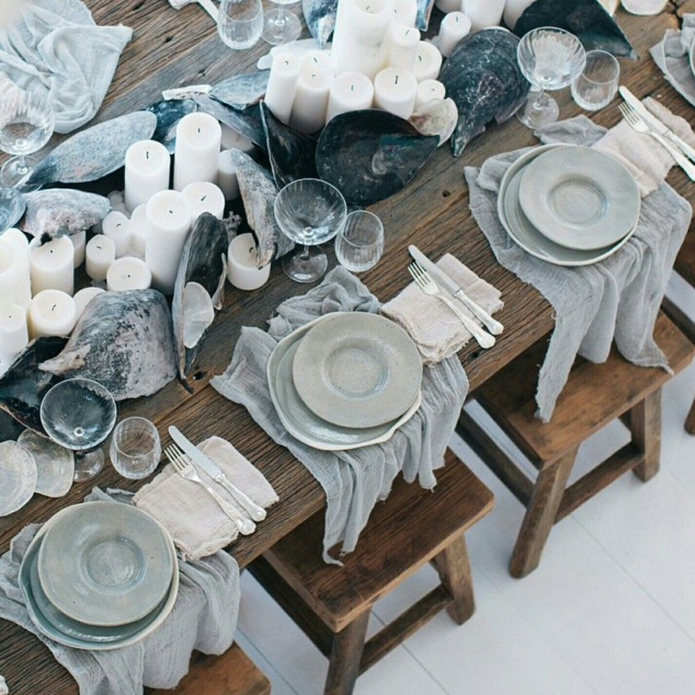 Stick to a common style and color scheme when stocking up on basics like china, napkins, glassware, and cutlery. That way, as you add more pieces things can easily be switched out without having to think too hard about it. image:  pinterest