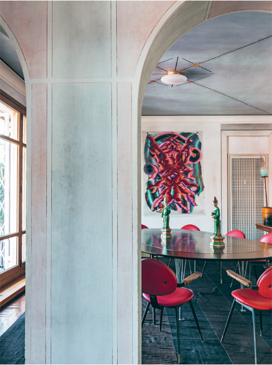 Nina Yashar's dining room, with a rare set of  Carlo Mollino  dining chairs and a painting by Kerstin Brätsch.