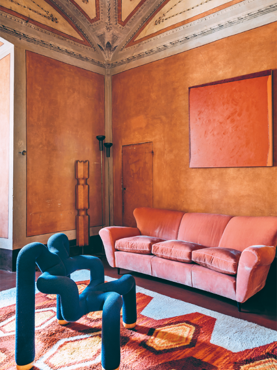 A Terje Ekström Ekstrem chair, Swedish Rya and Giuseppe Friscia painting in dramatic contrast to the stunning architecture at Roberto Baciocchi's 13th century Tuscan villa.