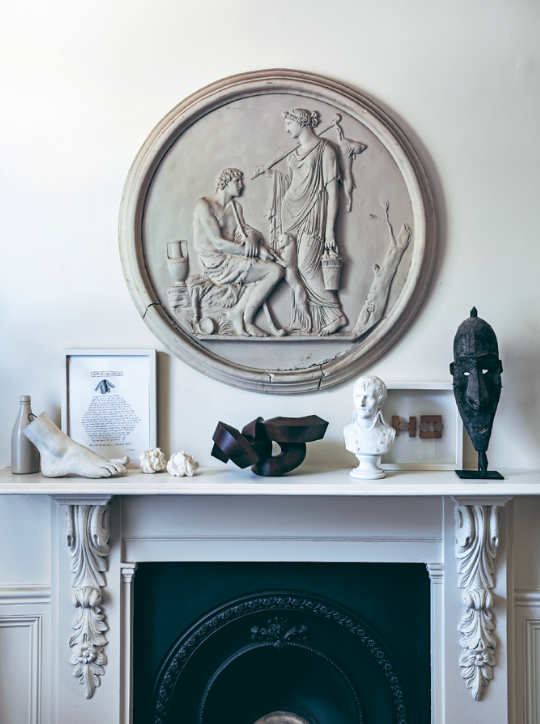18th Century and contemporary artworks enjoy equal prominence on the couple's mantle.