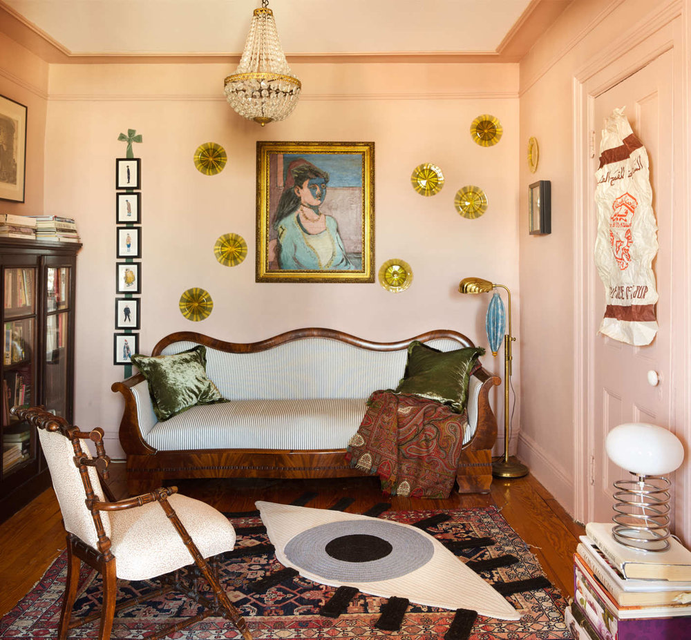 Charlap Hyman and Herrero founders Adam and Alexander Charlap Hyman's living room, with an eye rug by Katie Stout.  via the cut