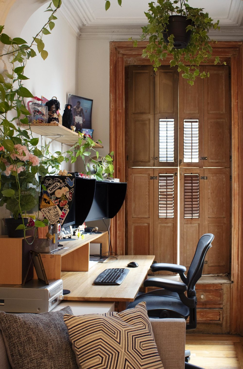 Juan's office in a nook at the front of the building, with original wooden shutters and built-in drawers below.