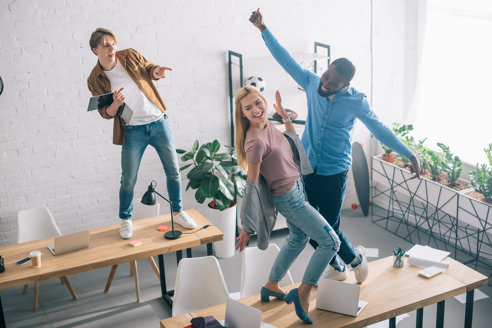 Wow! Look how much fun it is to work at GlobaX Gaming, we—-yeah we all work remotely and this is a stock image.