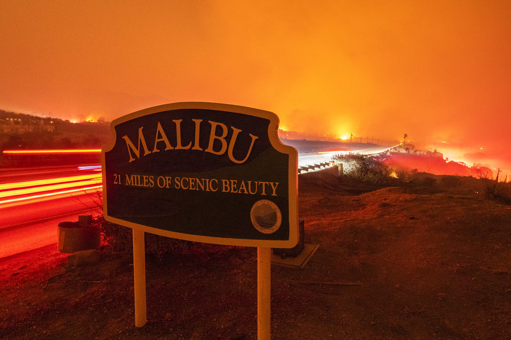 The Woolsey Fire burns to the Pacific Ocean in Malibu, late Friday Night November 9th.
