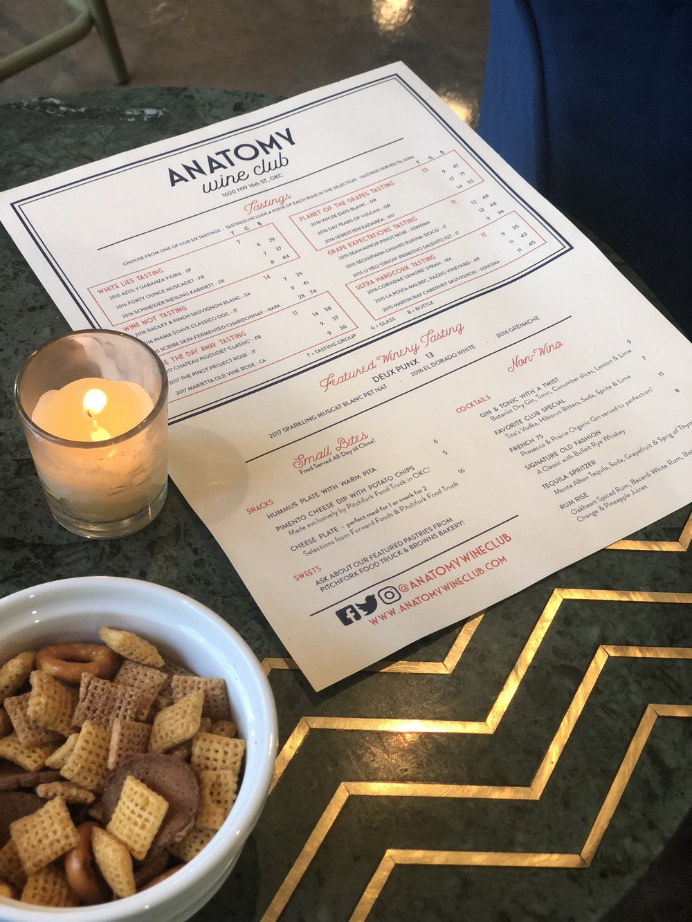 Menu and complementary Chex Mix at Anatomy Wine Club in the Plaza District