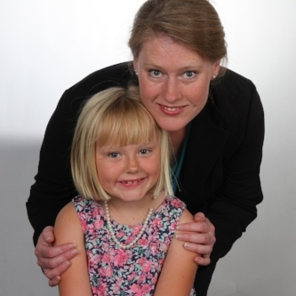 This is a photograph of Sarah Flickinger, a homemaker and community volunteer, with her daughter. Sarah is running for a seat on San Luis Obispo's City Council in 2018.