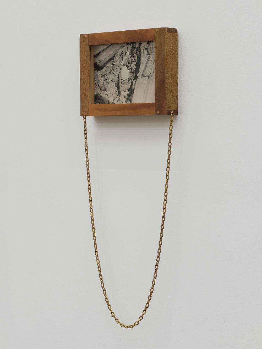 Will Rogan,  Eclipse Egg , 2018, Silver gelatin print, wood, clock chain, 22 x 8 1/2 x 1 1/2 in