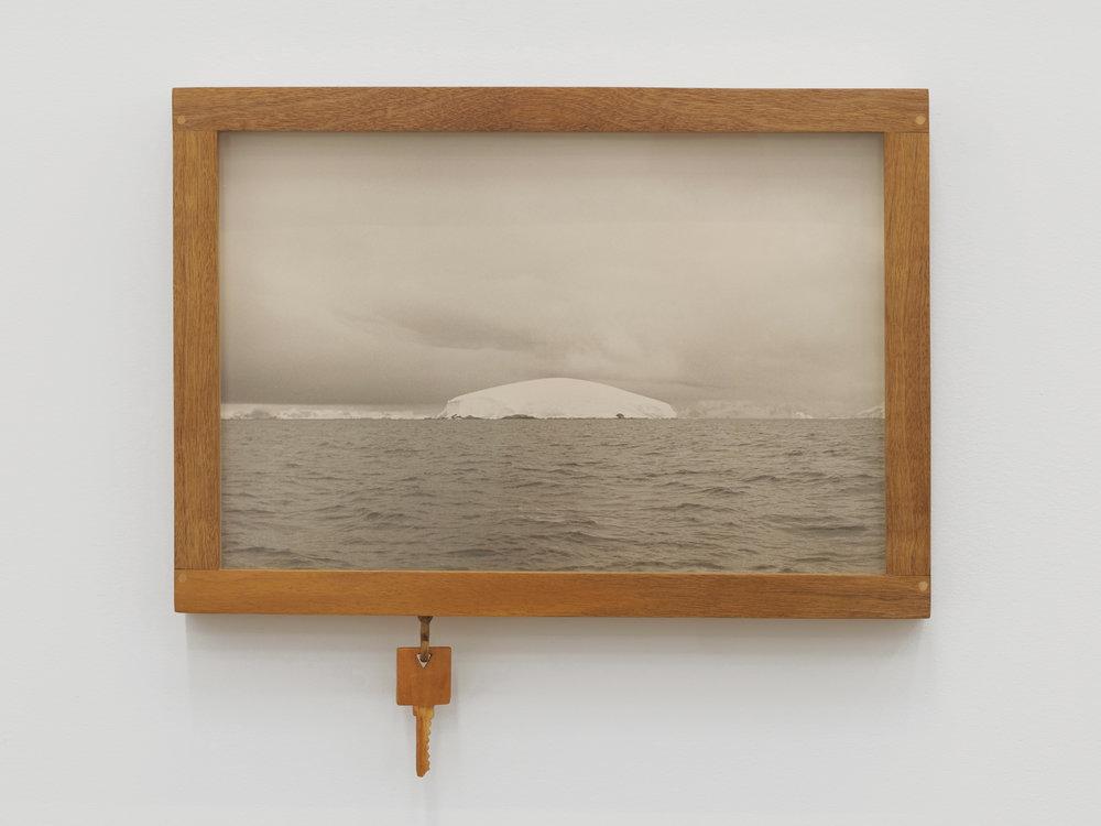Will Rogan,  Buls Island , 2018, gelatin silver print, wood, 14 x 15 1/4 x 1 1/2 in