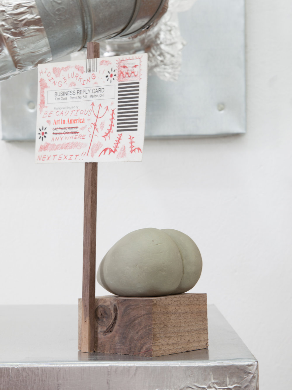 Harry Gould Harvey IV,  Art in America, IS EVERYWHERE! , 2018, Foraged Walnut from Aquidneck island, Foraged Clay from Swans Island, Art in America Mailer, & A Single Stainless Steel Nail. 9.5 x 5.5 x 3.5 inches
