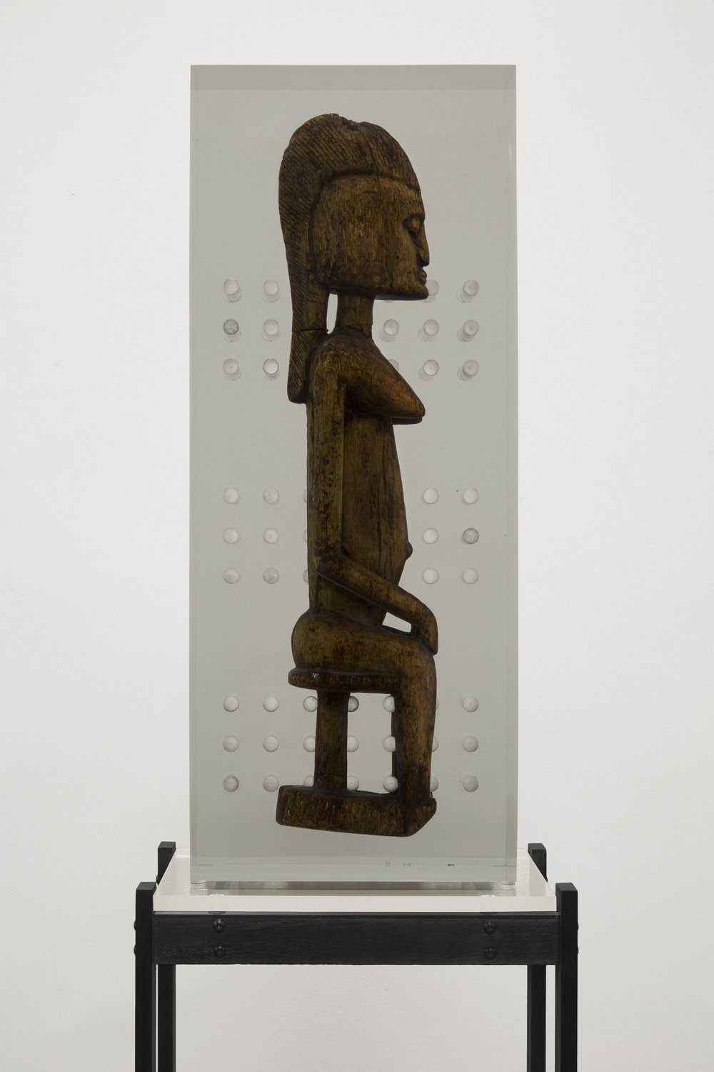 Matthew Angelo Harrison,  Dark Silhouette: Fixtured Woman , 2018, Wooden sculpture from West Africa, polyurethane. resin, anodized aluminum, acrylic. 72 x 23 x 15 1/2 inches