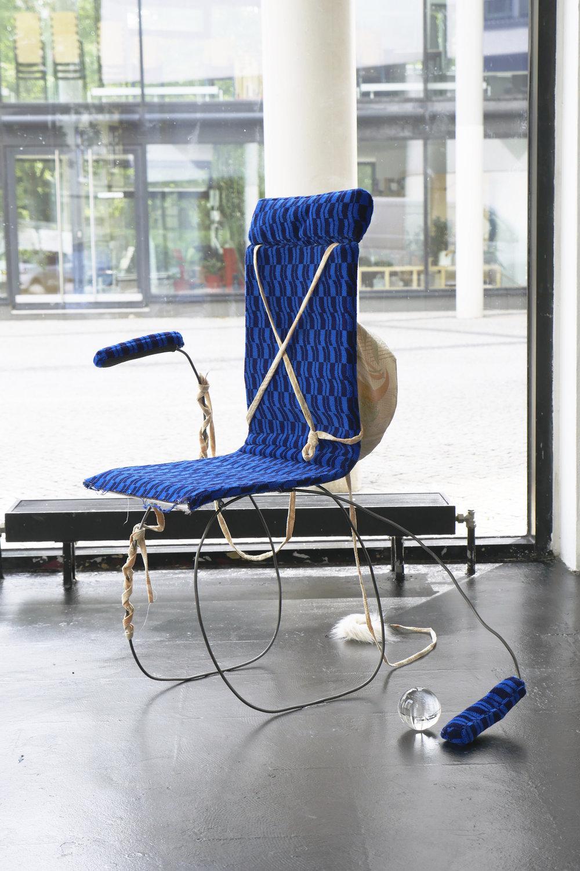 Nina Wiesnagrotzki,  Dragon II , 2018, Iron wire, fabric, wooden seat, crystal orb