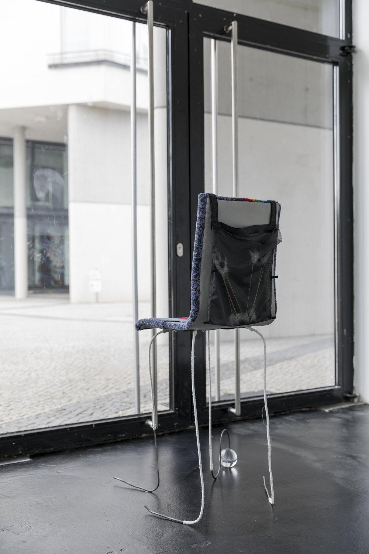 Nina Wiesnagrotzki,  Dragon III, 2018 . Iron wire, fabric, wooden seat, crystal orb