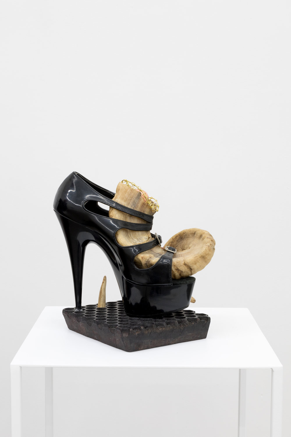 Genesis BREYER P-ORRIDGE,  Shoe Horn #3 , 2014, Ram horn, shoe worn by Genesis as Lady Sarah (he/r dominatrix persona), sting ray skin, ermine fur, bone, Nepalese fabric-printing square, brass netting, copper ball, 9 x 9 x 8 in