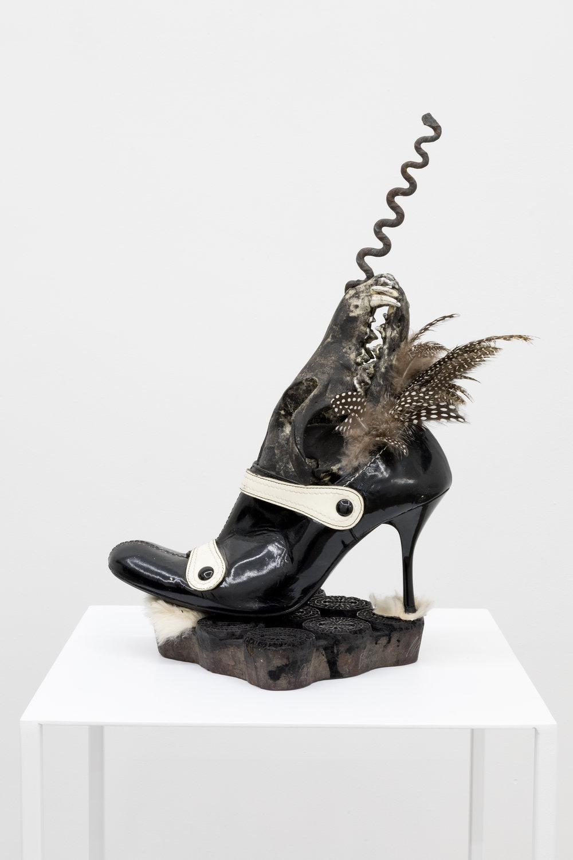 Genesis BREYER P-ORRIDGE,  Shoe Horn #7 , 2015, Horn, dominatrix shoe, Nepalese febric-printing square, skull, feathers, vodun relic, fur, 11 x 9 x 8 in