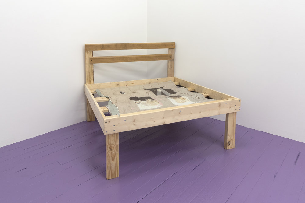 Amina Ross,  we are formalizing solidarity economies beyond familial bonds./ Re: Kali Akuno @ UIC/ Race & US Empire ,   2018, Used comforters from artist's family's flooded apartment, digital print on cotton blend , machine embroidery, and miniature wood bed frame made of reclaimed wood