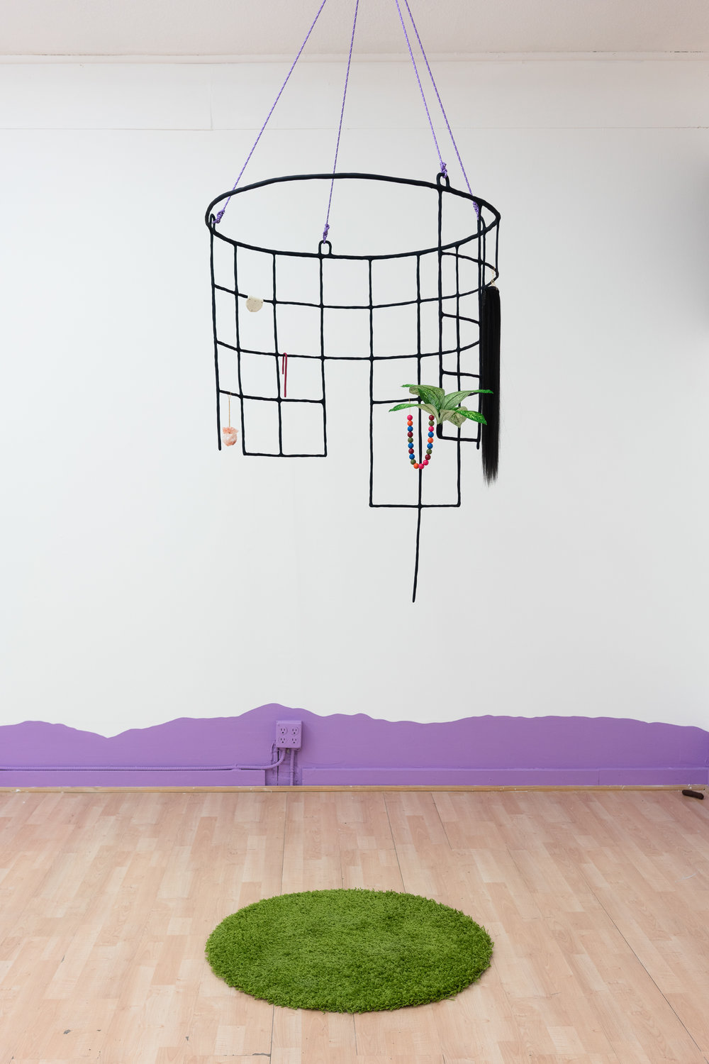 Stephanie Rohlfs,  Cage,  2018, Epoxy clay, paint, carpet, fake plant, fake hair, Himalayan salt crystals, plastic beads, chain, nylon cord, Dimensions variable