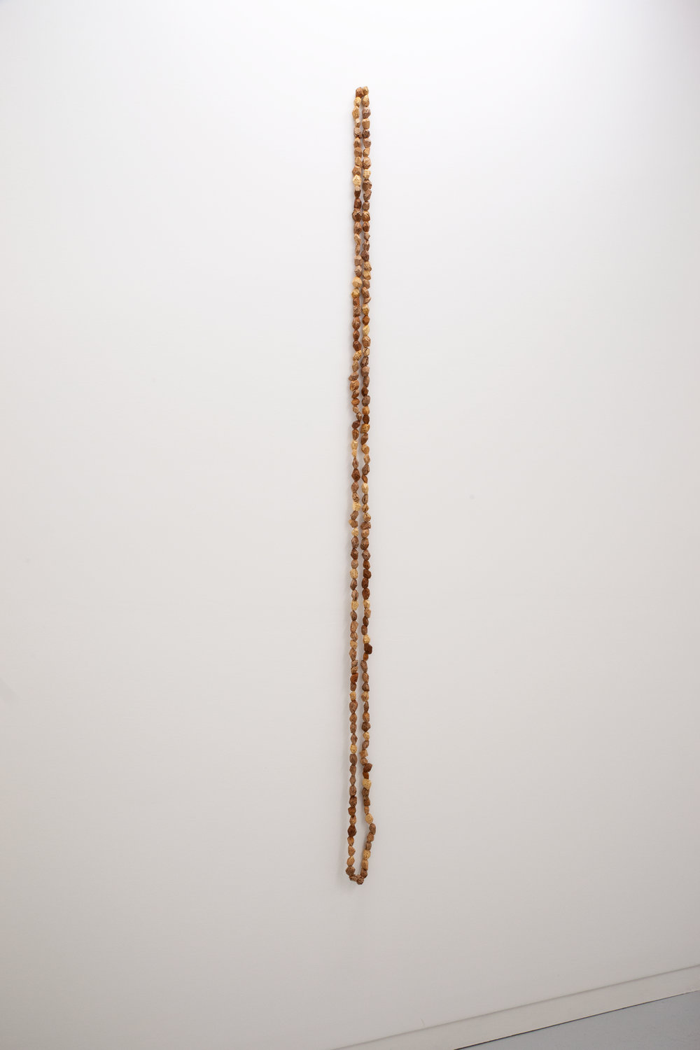 Elizabeth Atterbury,  Beads I , 2018, Peach Pits 77 x 1 x 1 in