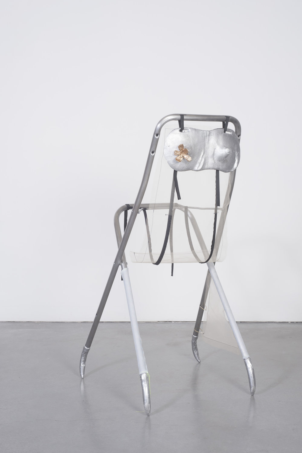 Ellie Hunter,  Trying it on , 2019, Cast aluminum, cast bronze, fabric, chair