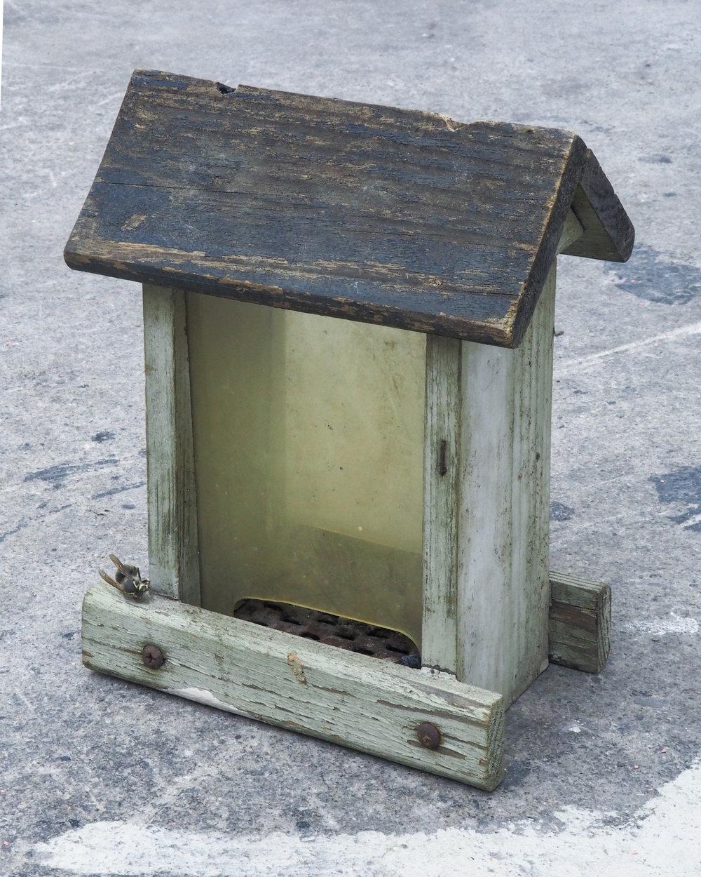 """Garrett Lockhart,  Untitled , 2019, found bird feeder, salvaged metal, Erzgebirge incense cone, wasp 6.5"""" x 9"""" x 4.5"""""""