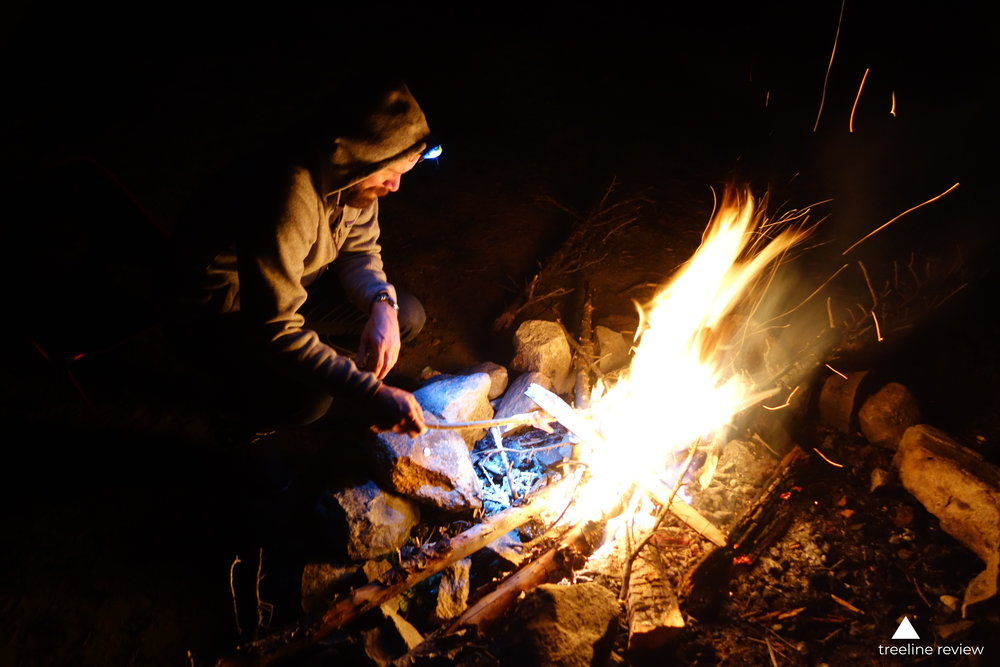 Our testers starting a campfire by the light from one of the headlamps we tried.   Photo by John Carr