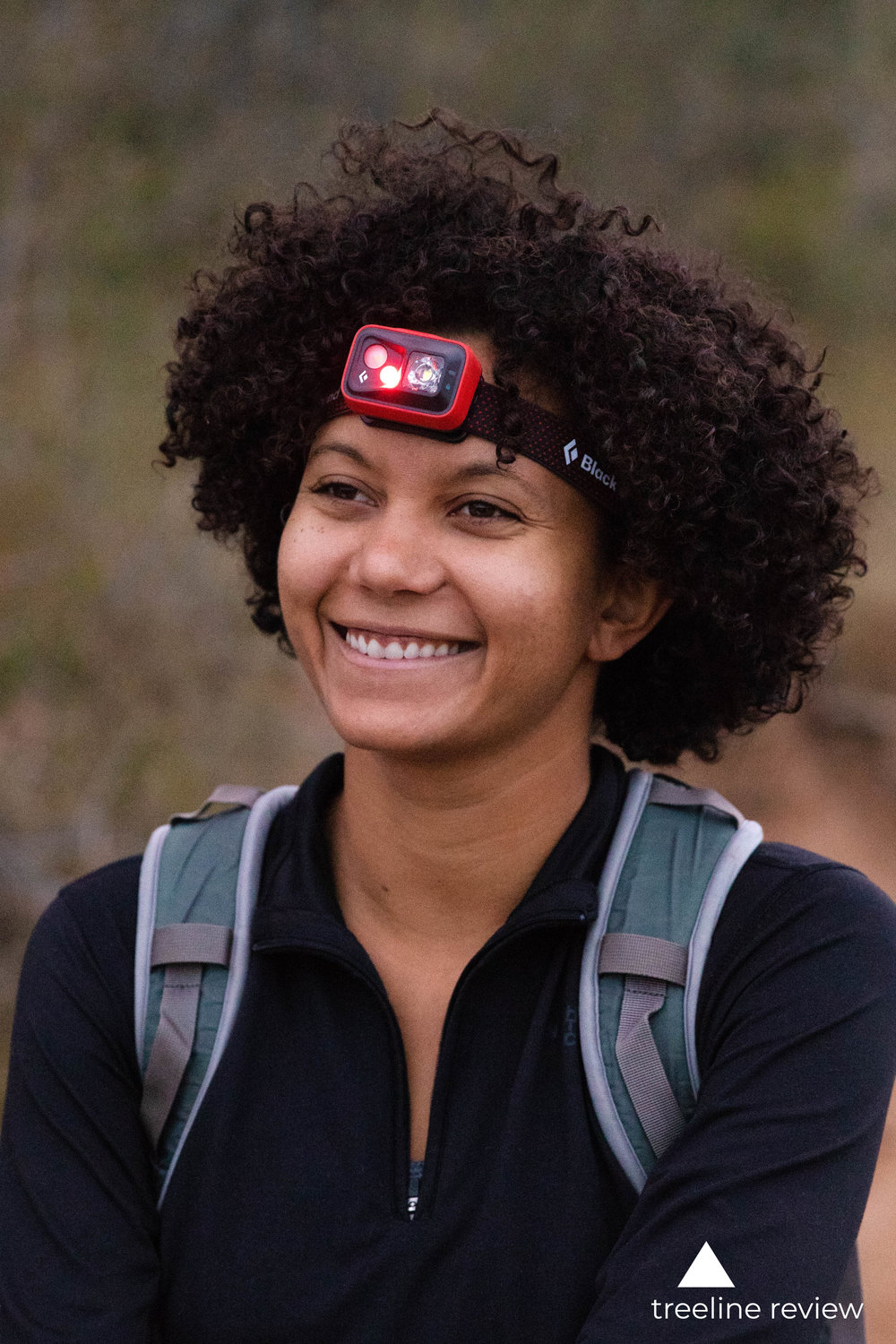 A quality headlamp should stay on your head without pinching or causing a headache.   Photo of Treeline Review writer Amanda Jameson by John Carr.